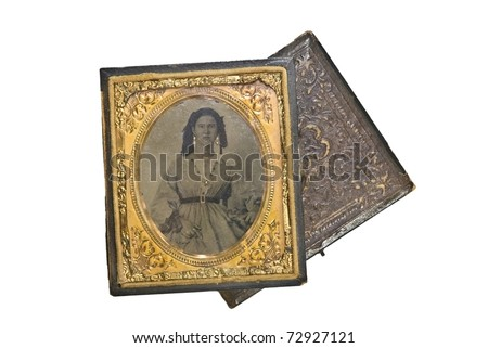 A beautiful small, antique, vintage photo of a woman in the 1800's. Tin type in leather case with gold trim and accents. - stock photo