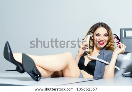 A beautiful smiling business woman talking on the phone - stock photo