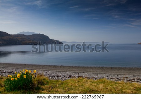 A beautiful spring day showing the beach and Loch Broom with the Summer Isles in the far distance at Ardmair Point near Ullapool Wester Ross, Northwest Scotland - stock photo