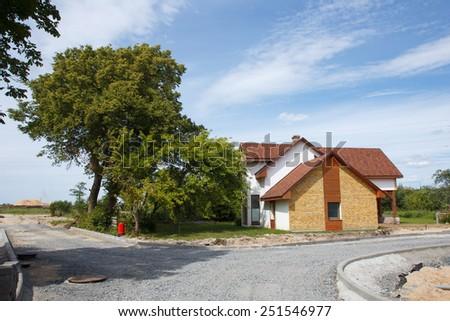 A beautiful subruban neighborhood with gravel streets - stock photo