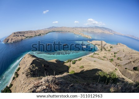 A beautiful tropical lagoon, fringed by coral, lies just north of the island of Komodo, a national park in Indonesia. This region is known for its large, predatory dragons and its diverse coral reefs. - stock photo