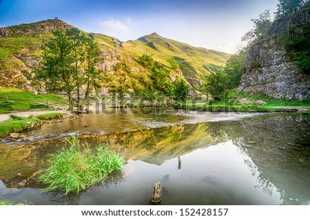 A beautiful view of the river Dove and stepping stones at Dovedale in the English Peak District - stock photo