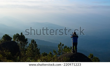 A beautiful view with one man on the top of mountain,Thailand - stock photo