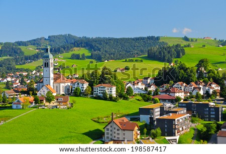 A beautiful village nested in the hills of Appenzellerland, Canton Appenzell, Switzerland - stock photo