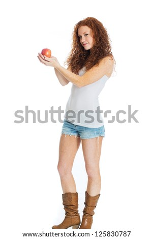 A beautiful woman holding an apple. - stock photo