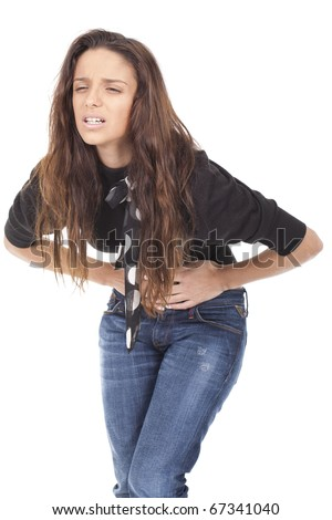 a beautiful woman suffering from stomachache - stock photo