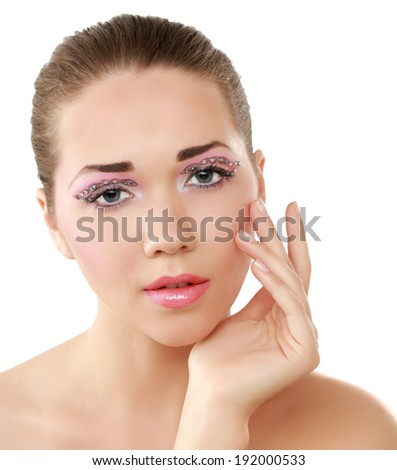 A beautiful woman touching her face, isolated on white background - stock photo