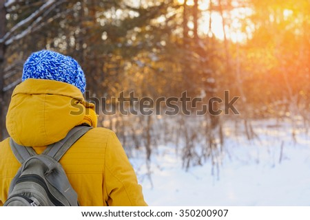 A beautiful woman travels in the winter - stock photo