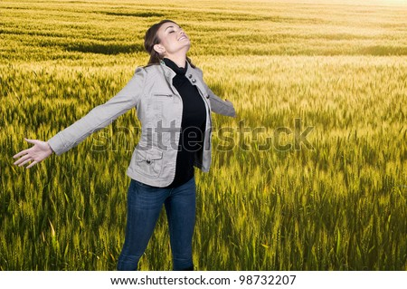 A beautiful woman with a cold, hay fever or allergies blowing her nose - stock photo