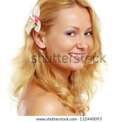 A beautiful woman with a flower in her hair, isolated on white background - stock photo