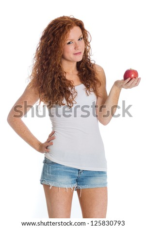 A beautiful woman with a healthy apple. - stock photo