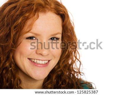 A beautiful woman with red hair and freckles - stock photo