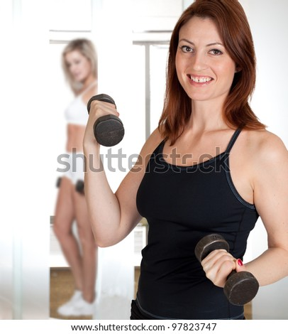 A beautiful woman working out with weights - stock photo