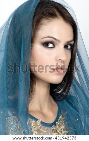 A beautiful women under blue veil. Beauty portrait - stock photo