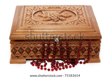 A beautiful wooden box and the beads isolated on white background - stock photo