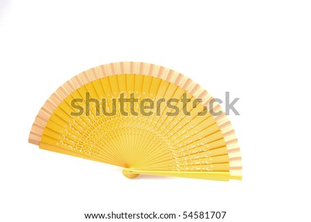 A beautiful yellow  fan from Spain isolated on white background - stock photo