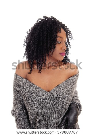 A beautiful young African American woman standing waist up in a gray