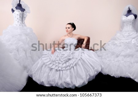 a beautiful young bride in white dress - stock photo