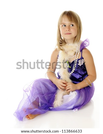 A beautiful young elementary girl looking beautiful in a purple dress, beads and a  pale pink boa.  On a white background. - stock photo