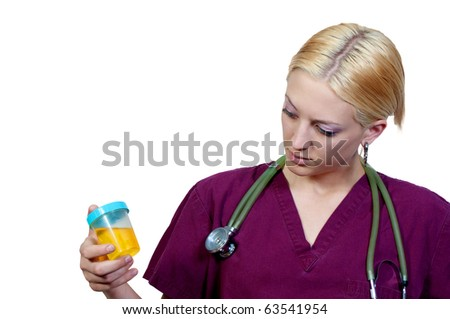 A beautiful young female doctor on her rounds - stock photo