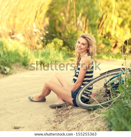 a beautiful young girl and vintage bike - stock photo