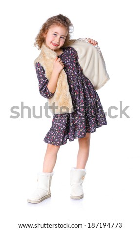 A beautiful young girl dressed for winter, over a white background - stock photo