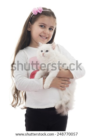 A Beautiful Young Girl Playing with Her Cat Isolated on White Background - stock photo