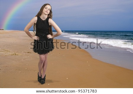 A beautiful young teenage woman at the beach - stock photo
