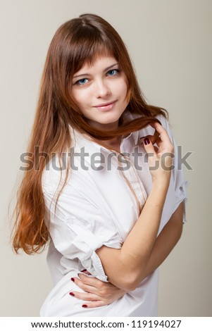 A beautiful young woman in a white shirt - stock photo
