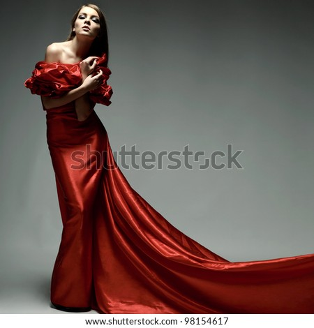 A beautiful young woman is in red clothes - stock photo