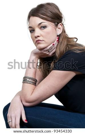 A beautiful young woman looking far away - stock photo