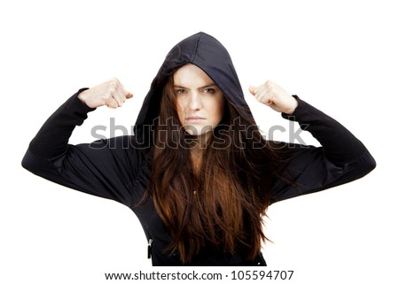 A beautiful, young woman looking menacing looks straight at the camera. Way of expressing emotion. - stock photo