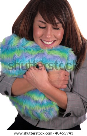 a beautiful young woman loves her colorful fuzzy pillow, isolated on white - stock photo