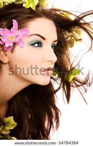 A beautiful young woman with flowers in her hair. - stock photo