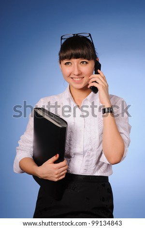 A beauty business woman hold folder and calling - stock photo