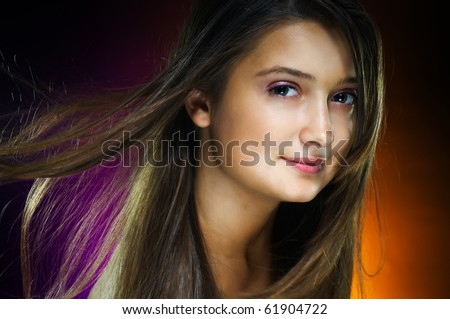 a beauty girl on the dark background - stock photo