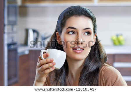 a beauty girl on the kitchen background - stock photo