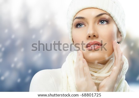 a beauty girl on the winter background - stock photo