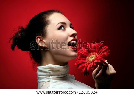 a beauty happy girl with red flower - stock photo