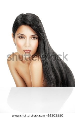 a beauty portrait of a young woman, shot on white background. she is bent forward and her long, black hair  flows on her back - stock photo
