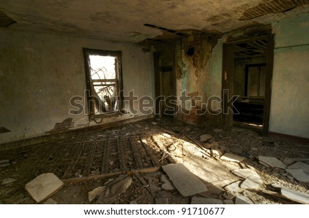 A Bedroom left in Rubble in an Abandoned House - stock photo