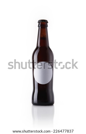 A beer glass bottle with liquor with blank circle label reflective bottom isolated white. - stock photo