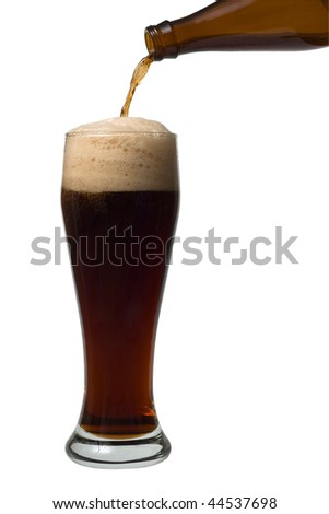 A beer pouring into a glass on the white background - stock photo