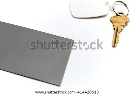 A behind the scenes image of grey card positioned near key to be photographed. Grey card is a tool used for exposure and white balance in photography. Over white, not isolated. - stock photo