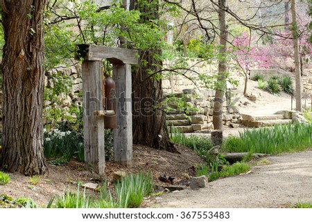 A bell hung in a Japanese style garden. - stock photo