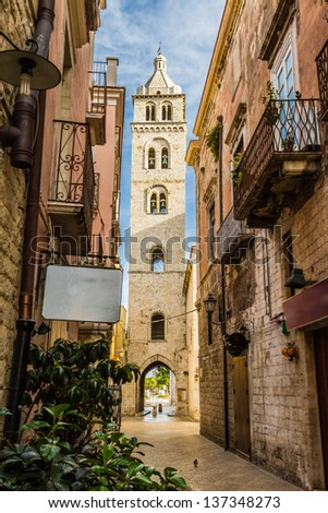 A bell tower seen through an alleyway in Barletta - stock photo