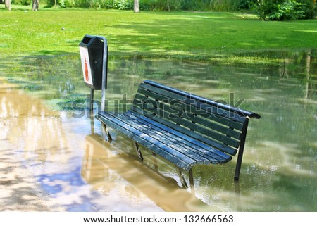 A bench in a flooded park in Amsterdam - stock photo