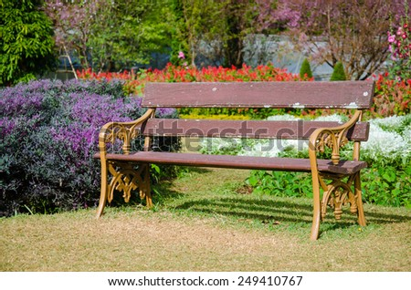 A Bench In The Botanical Garden. - stock photo
