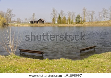 A bench surrounded by water  - stock photo