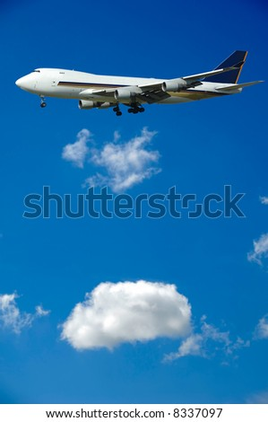 A big jumbo plane and fluffy clouds - stock photo